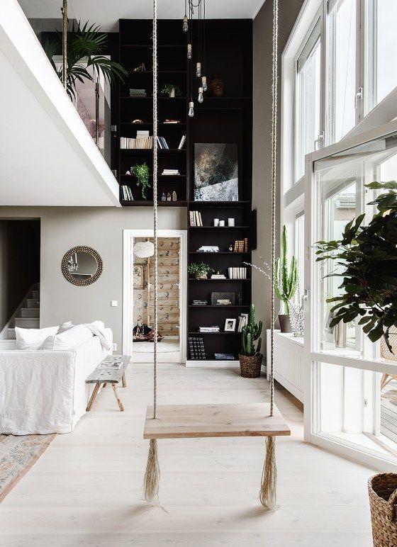 Loft noir et blanc avec balançoire